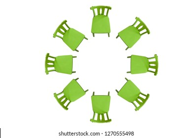 Green chairs in a circle on a white background. Background. Insulator