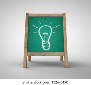 green chalkboard with drawing lamp on gray background