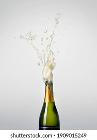 Green Champagne Bottle Exploding for Celebration