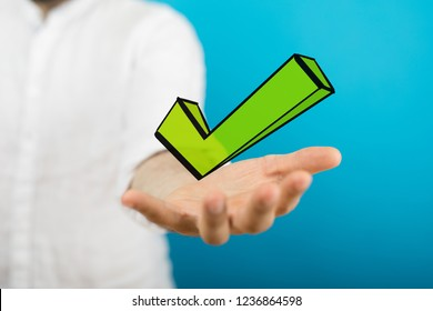 green checkmark in hand