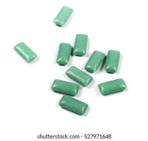 green chewing gum isolated on white
