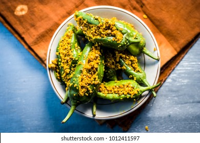 Green chilli pickle marinated in mustard seeds and mustard oil.