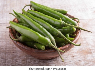 green chilly on wooden background