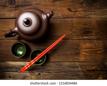 Green chinese tea on wooden table. Top view with copy space