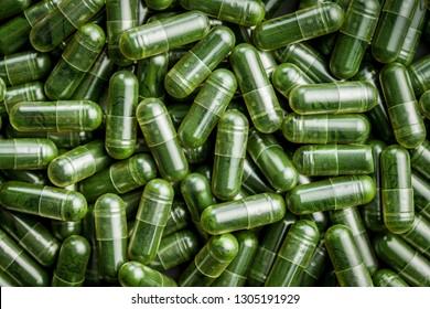 Green chlorella pills or green barley pills. Texture.