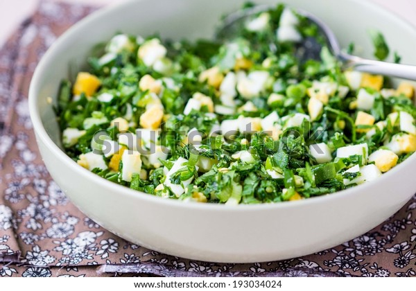 Green chopped eggs salad with parsley, ramson, spring onion, summer dish