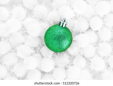 Green christmas ball on snow balls on white background