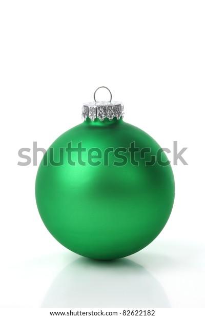 Green christmas ball on white background.