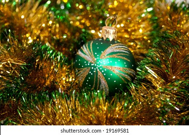 Green Christmas bauble on garland