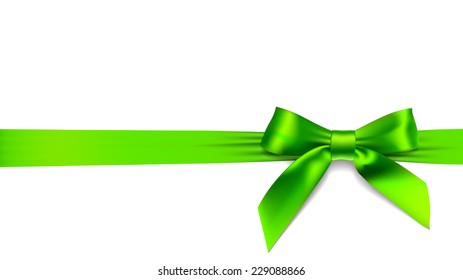 Green Christmas bow on red background