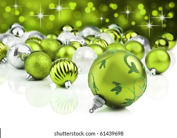 Green christmas ornaments with star background