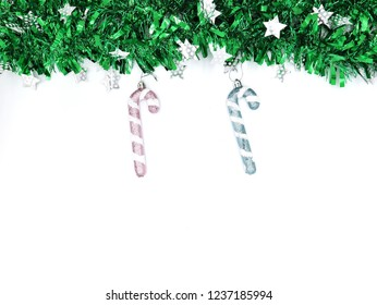 Green Christmas tree background star and candy cand , white background with place for text