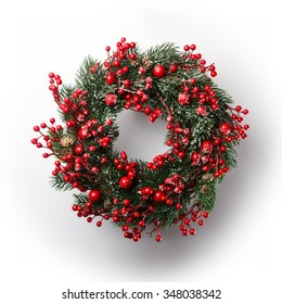 green christmas wreath with decorations isolated on white background