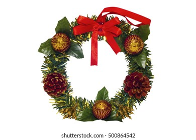 green christmas wreath with decorations on white background