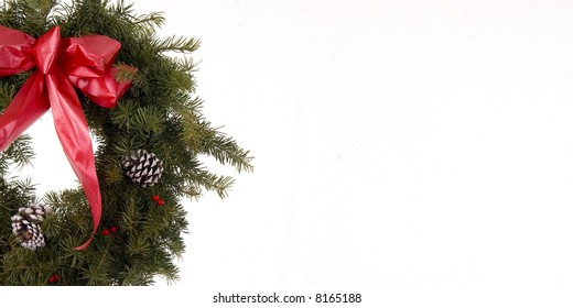 Green Christmas wreath isolated on a white background perfect for christmas Cards and tags.