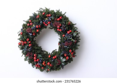 green christmas wreath on white background