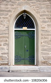 Green church door on sandstone church