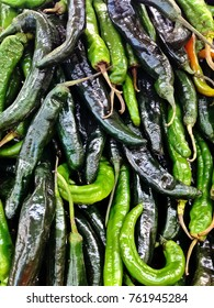 Green Cilaca (PASILLA) peppers stacked on display at local market