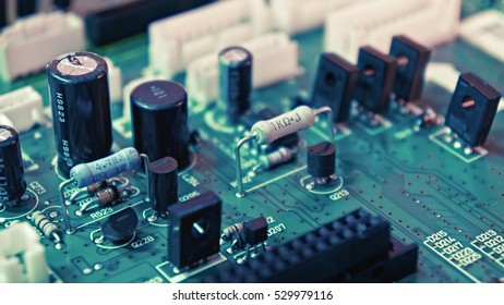 A green circuit board with electronic components.