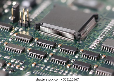 Green Circuit board with microprocessor and other electronic components