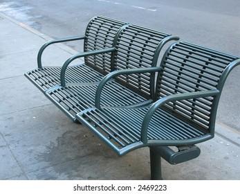 Green city bench from sidewalks of Manhattan.