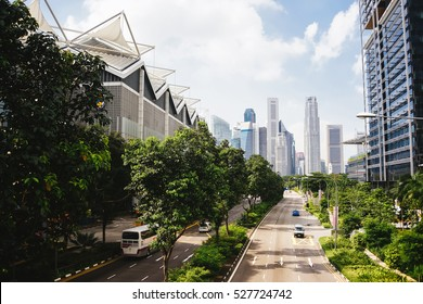 Green city of the future. City of the future. Harmony of city and nature. Sunny day in the big city. Deserted quarter, streets without people