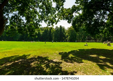 green city park during a sunny day , place of urban rest for citizens in a holyday with fine weather ,
