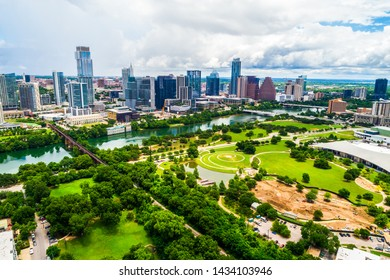 Green Cityscape of Austin Texas aerial drone view above Green Spaces and Modern Parks with Skyline background