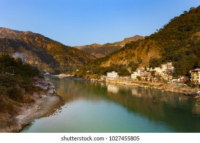 Green and clean Ganges River at sunset in Rishikesh, Uttarakhand, India.