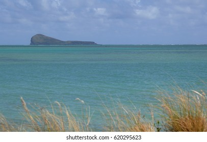 Green clean water of Indian ocean in Mauritius
