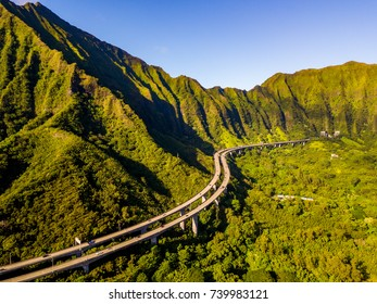 Green cliffs and mountains on the island of Oahu, Hawaii with the world famous Haiku stairs or the stairs to heaven. Ho'omaluhia Botanical Garden in Kaneohe