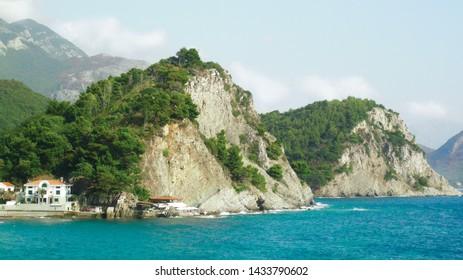 Green cliffs on the Adriatic coast. Blue sea. Adriatic Sea. Montenegro. Petrovac
