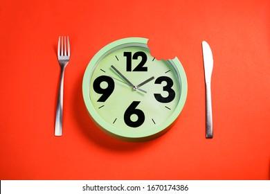 green clock bitten and cutlery