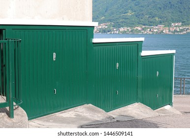 Green closed garage doors on lake coast