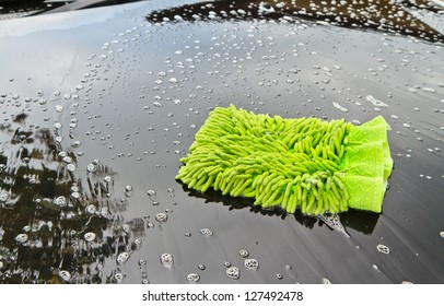 Green cloth over the car for washing