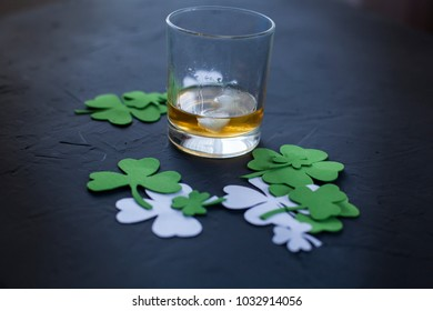 Green clover leaf on black background. St Patrick's Day concept, ornament and frame