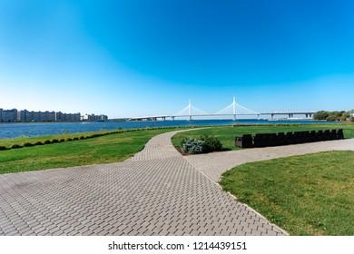 Green coast of the sea with bridge in noon - Shutterstock ID 1214439151