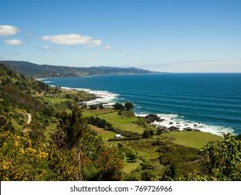 Green coastline along Valdivia in Chiles fertile middle.