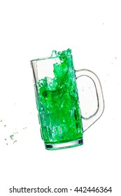 Green cocktail  splash from glass on a white background.