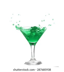 of green cocktail with splash isolated on white background