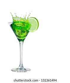 Green cocktail with splash and lime isolated on white