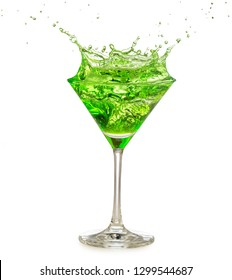 green cocktail splashing in martini glass isolated on white