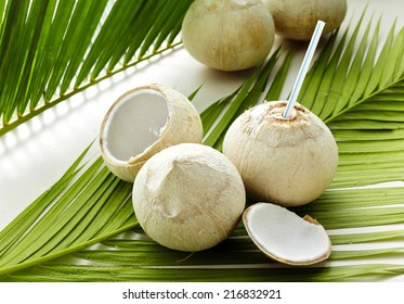 Green coconut on white Leaves  background