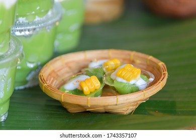 Green coconut sweet pudding and corn. Thai traditional dessert.