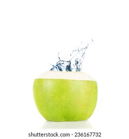 Green coconut with water splash, Isolated over white