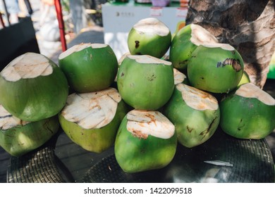 green coconuts on the street of sanya