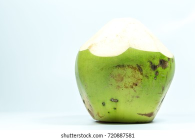Green coconuts on white  background