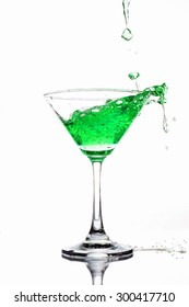 Green coctail splash on white background close up