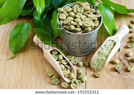 Green coffee - beans and ground. Selective focus.