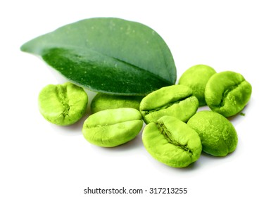 Green coffee beans with leaf isolated on white